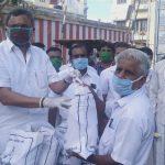 Mr. Karti Chidambaram while distributing essential items to the general public of the Yemaneswaram region of Paramakudi town.